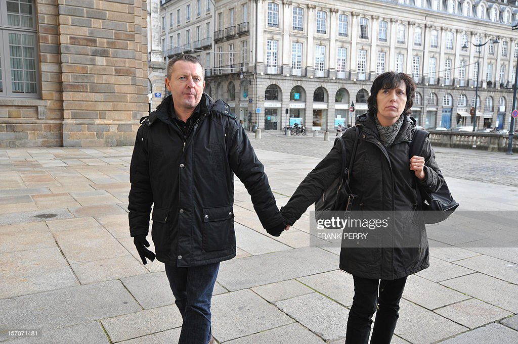 French Didier Jambart (L) leaves with his wife Christine Jambart, the courthouse in Rennes, western France, on November 28, 2012, after the appeal court rendered its verdict. The court upheld a ruling ordering pharmaceutical giant, British GlaxoSmithKline to pay 197,000 euros (some 254,000 US dollars) to Didier Jambart who claimed that the drug Requip to treat Parkinson's turned him into a gay sex and gambling addict. PERRY
