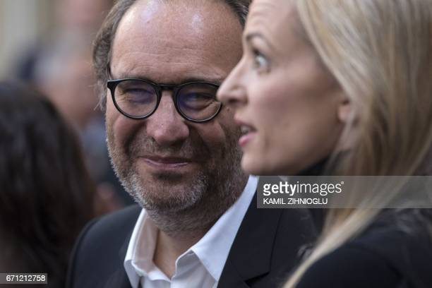 French digital businessman Xavier Niel and his partner Delphine Arnault attend a reception for Microsoft cofounder Bill Gates at the Elysee Palace in...