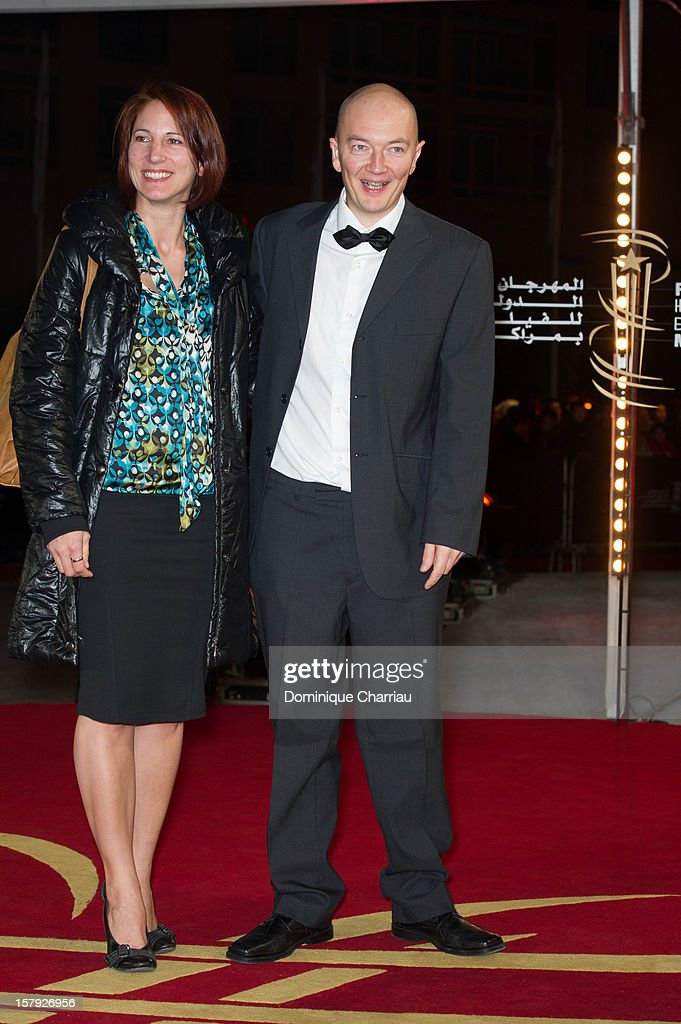 French Directoe Samuel Collardey (R) and guest pose as they arrive at the 'Ginger & Rosa' Premiere during the 12th International Marrakech Film Festival on December 7, 2012 in Marrakech, Morocco.