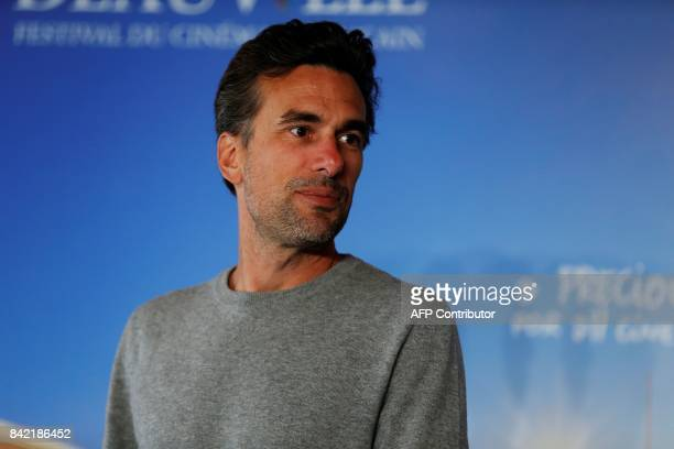 French director Alexandre Moors poses during a photocall for the film 'The Yellow Birds' at the 43rd Deauville US Film Festival in the northwestern...