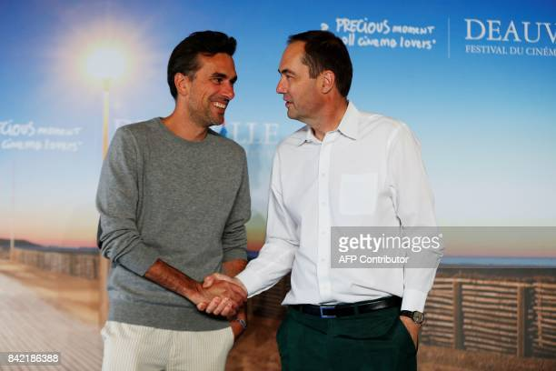 French director Alexandre Moors shakes hand with British cinematographer Daniel Landin as they poses during a photocall for the film 'The Yellow...