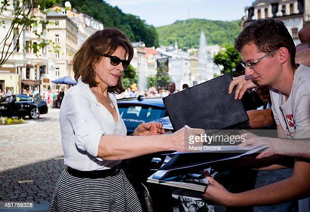 French director and actress Fanny Ardant signs autographs for fans at the 49th Karlovy Vary International Film Festival on July 6 2014 in Karlovy...