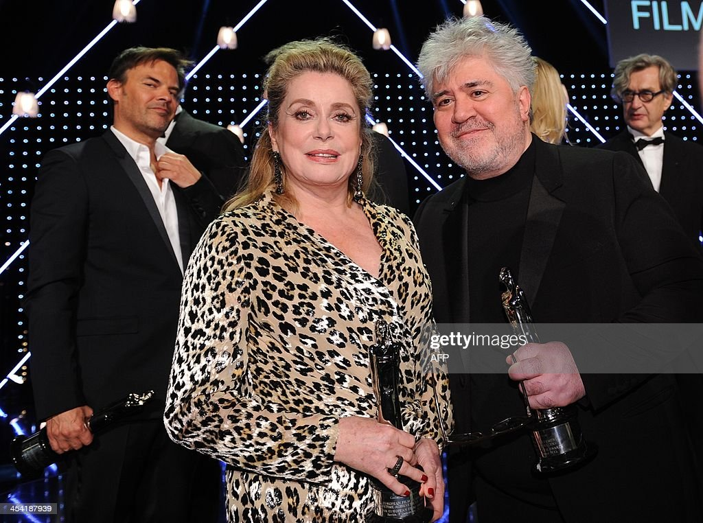 French director and script writer Francois Ozon, French actress Catherine Deneuve and Spanish director Pedro Almodovar pose with their awards at the 26th European Film Awards ceremony on December 7, 2013 in Berlin. Every year, the various activities of the European Film Academy culminate in the ceremony of the European Film Awards. In a total of 21 categories, among them European Film, European Director, European Actress and European Actor, the European Film Awards annually honour the greatest achievements in European cinema.