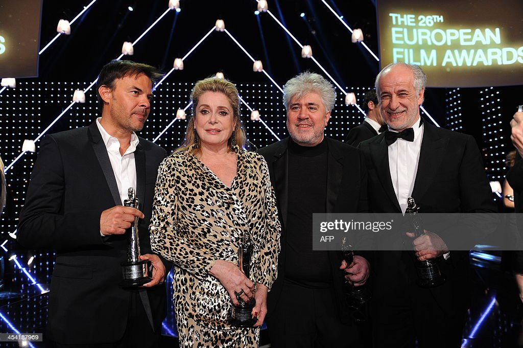 French director and script writer Francois Ozon, French actress Catherine Deneuve, Spanish director Pedro Almodovarand italian actor Toni Servillo pose with their awards at the 26th European Film Awards ceremony on December 7, 2013 in Berlin. Every year, the various activities of the European Film Academy culminate in the ceremony of the European Film Awards. In a total of 21 categories, among them European Film, European Director, European Actress and European Actor, the European Film Awards annually honour the greatest achievements in European cinema.