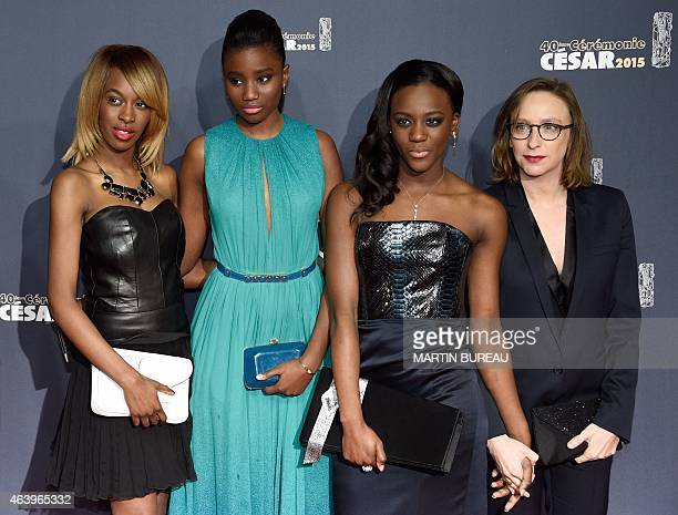 French director Celine Sciamma poses with the cast of her film 'Bande de Filles' Marietou Toure Karidja Toure and Assa Sylla as they arrive for the...