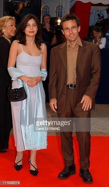 French Director Claude Lelouch opens thirtieth Deauville film festival David Pujadas and girlfriend in Deauville France on September 03 2004