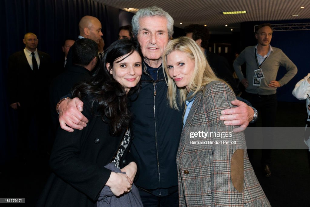 French director Claude Lelouch (C) poses with his daughters Salome (L) and Sarah during the premiere of Lelouch's film 'Salaud, on t'aime' (Bastard, we love you) at Cinema UGC Normandie on March 31, 2014 in Paris, France.