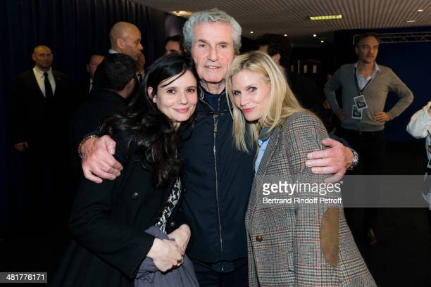 French director Claude Lelouch poses with his daughters Salome and Sarah during the premiere of Lelouch's film 'Salaud on t'aime' at Cinema UGC...