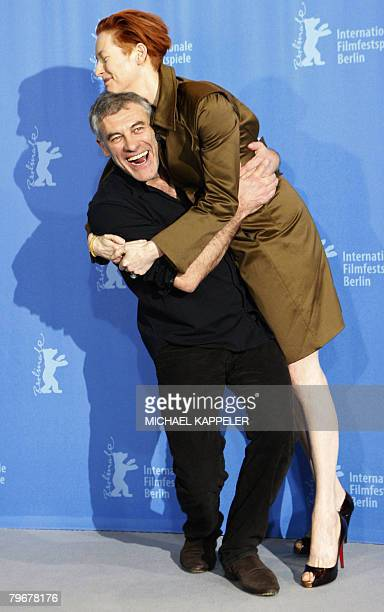 French director Erick Zonca and British actress Tilda Swinton joke during the photocall of their movie 'Julia' presented in competition for the...