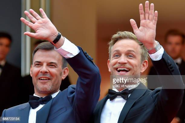 French director Francois Ozon and Belgian actor Jeremie Renier wave as they arrive on May 26 2017 for the screening of the film 'L'Amant Double' at...