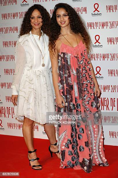French director Houda Benyamina poses with French actress Oulaya Amamra during a photocall upon arriving to attend the Diner de la Mode fundraiser...