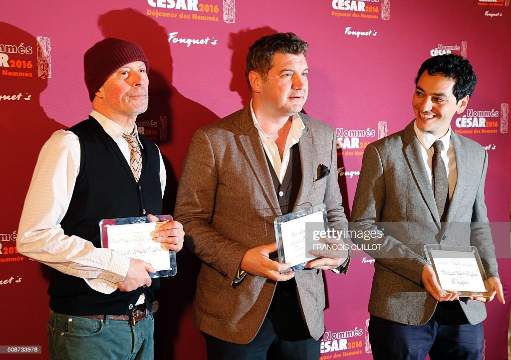French director Jacques Audiard, French screenwriter Thomas Bidegain (L) and French actor Noé Debré pose with their nomination certificates for Best Original Screenplay and Best First Feature Film during the nominations event for the 2016 César film awards, on February 6, 2016 in Paris. The 41st Ceremony for the Cesar film award, considered as the highest film honour in France, will take place on February 26, 2016. / AFP / FRANCOIS GUILLOT