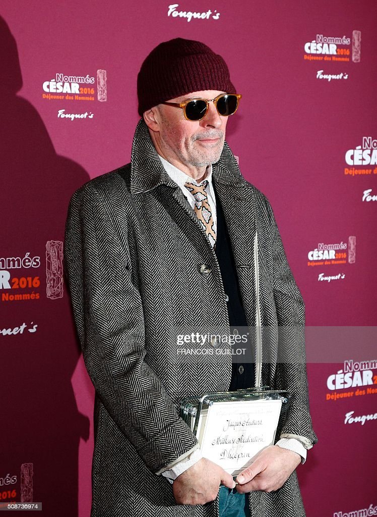 French director Jacques Audiard poses with his nomination certificates for Best Original Screenplay, Best Direction and Best Feature Film during the nominations event for the 2016 César film awards, on February 6, 2016 in Paris. The 41st Ceremony for the Cesar film award, considered as the highest film honour in France, will take place on February 26, 2016. / AFP / FRANCOIS GUILLOT