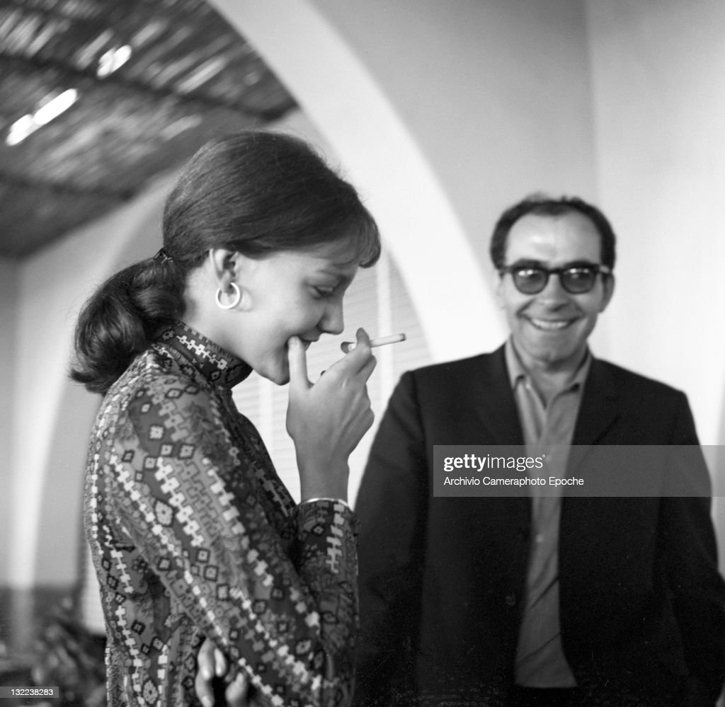 French director Jean Luc Godard with Anne Wiazemsky after lunch, Lido, Venice, 1967.