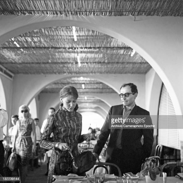 French director Jean Luc Godard with Anne Wiazemsky at the restaurant Lido Venice 1967