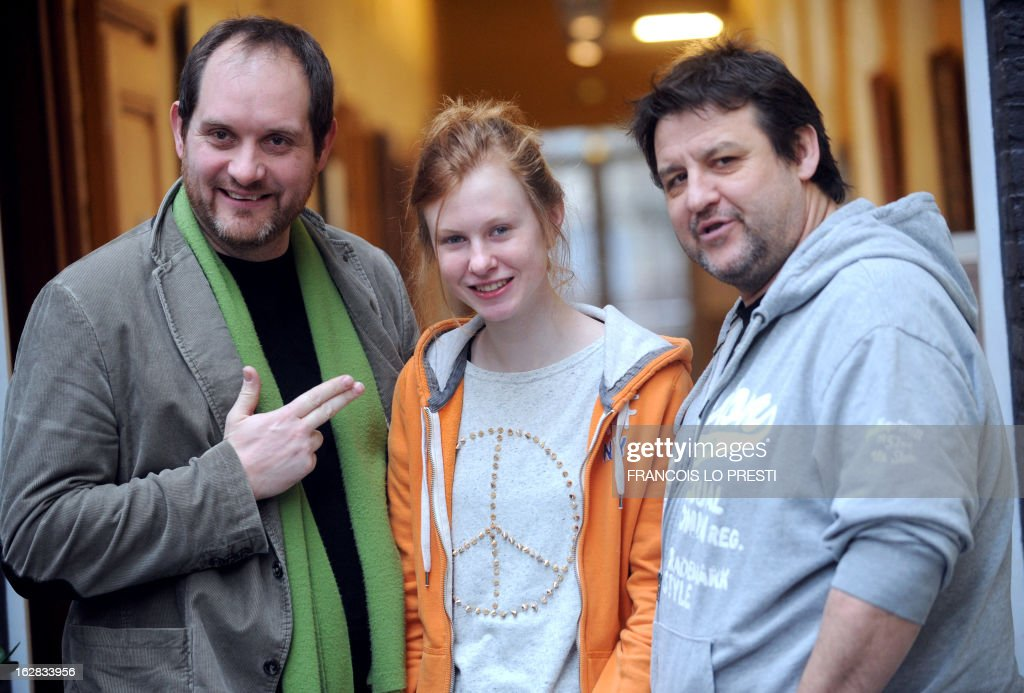 French director Joel Franka, French actress Mathilde Goffart and French actor Guy Lecluyse pose on February 26, 2013 in Lille, northern France, after a press presentation of the French movie 'Une chanson pour ma mere'.