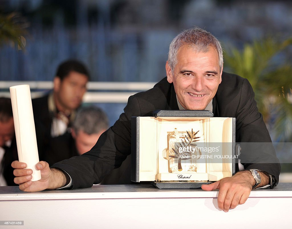 French director Laurent Cantet celebrates during a photocall after winning the Palme d'Or award for his film 'Entre Les Murs (The Class)' during the Closing Ceremony of the 61st Cannes International Film Festival on May 25, 2008 in Cannes, southern France. The French film 'Entre Les Murs (The Class) about an inspired teacher in a tough urban school won the Palme d'Or top prize at Cannes, the first homegrown movie in 21 years to claim the coveted award.