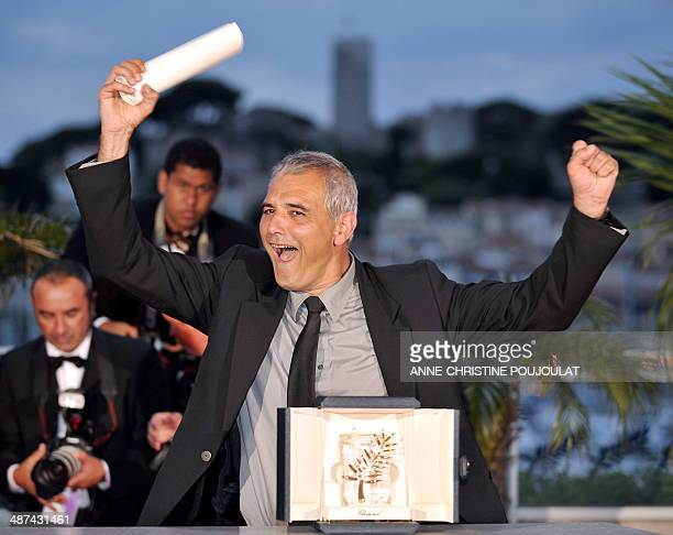 French director Laurent Cantet celebrates during a photocall after winning the Palme d'Or award for his film 'Entre Les Murs ' during the Closing...