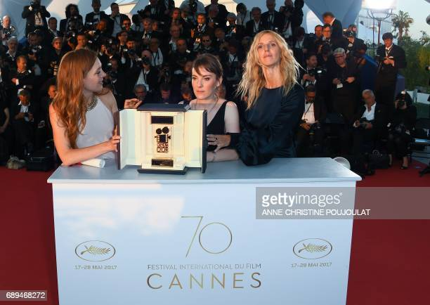 French director Leonor Serraille French actress Laetitia Dosch and French actress and President of the Camera d'Or jury Sandrine Kiberlain attend on...