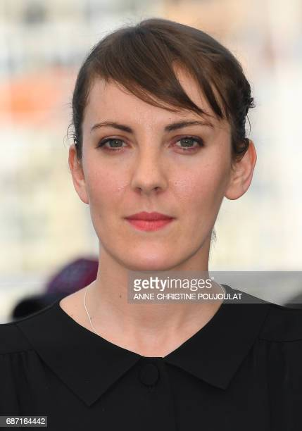 French director Leonor Serraille poses on May 23 2017 during a photocall for the film 'Jeune Femme' at the 70th edition of the Cannes Film Festival...