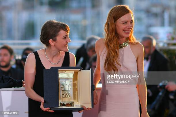 French director Leonor Serraille poses on May 28 2017 during a photocall with French actress Laetitia Dosch after she won the Camera d'Or prize for...