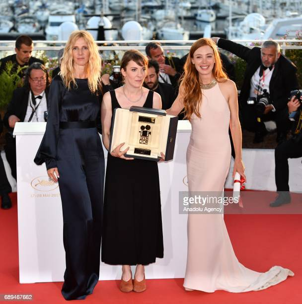 French director Leonor Serraille poses with actress Laetitia Dosch and Sandrine Kiberlain during the Award Winners photocall after she won the Golden...