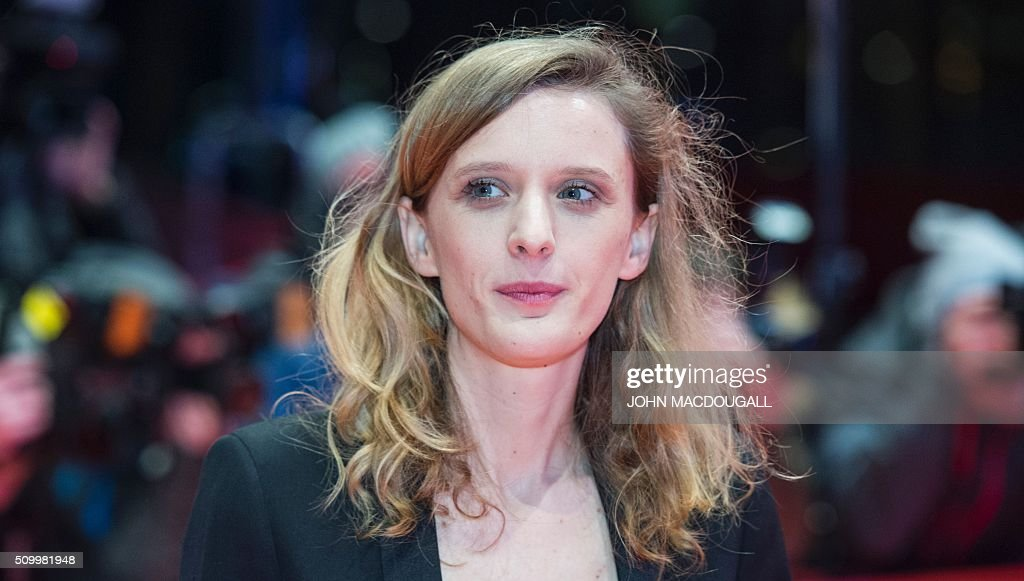 French director Mia Hansen-Love poses on the red carpet prior to the screening of the film 'L'Avenir' (Things to Come) in competition at the 66th Berlinale Film Festival in Berlin on February 13, 2016. / AFP / John MACDOUGALL