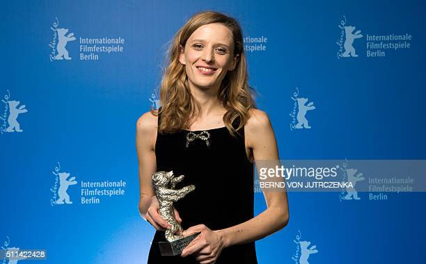 French director Mia HansenLove speaks after receiving the Silver Bear for Best Director for the film 'L'Avenir' poses during a photocall at the...