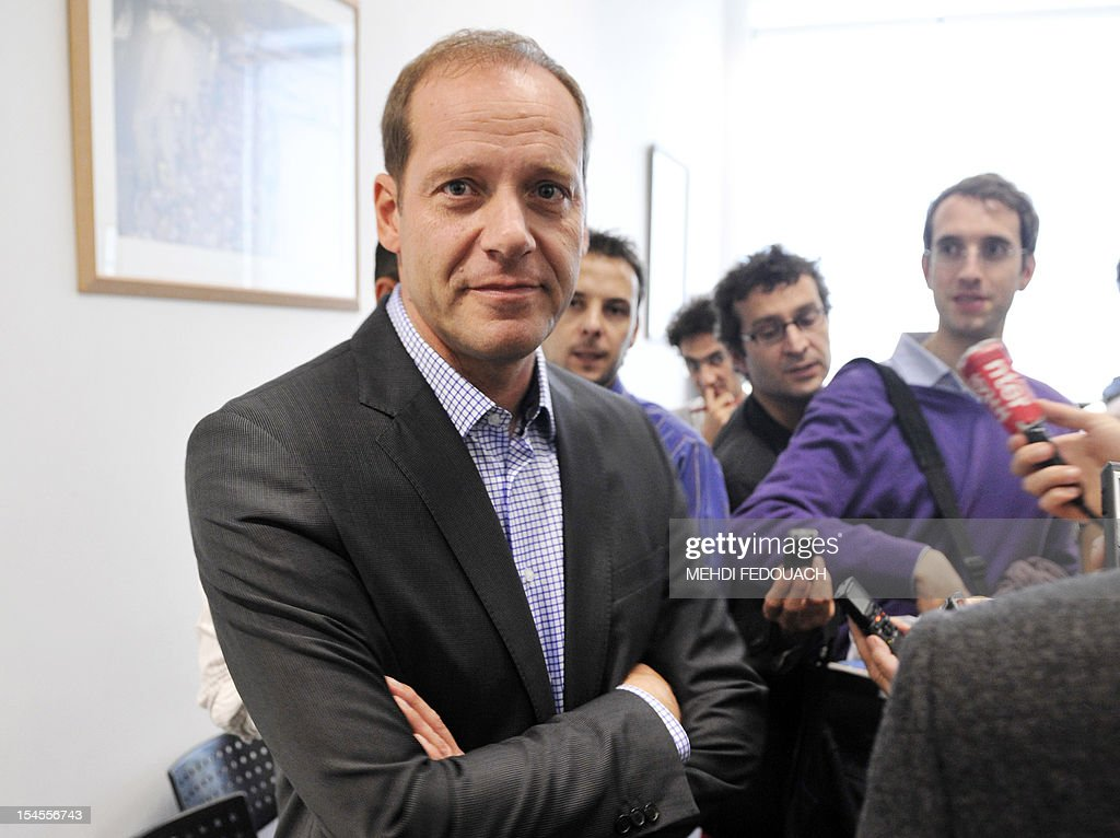 French director of Tour de France cycling race, Christian Prudhomme, arrives for a press conference on October 22, 2012 in Issy-les-Moulineaux, near Paris, after US cyclist Lance Armstrong was banned by the International Cycling Union (UCI) as the world cycling body upheld an earlier doping sanction handed to the seven-times Tour de France champion. The UCI said it would not contest sanctions already handed down by the US Anti-Doping Agency (USADA), stripping the cancer survivor of all of his results since August 1998 and earning him a ban for life. AFP PHOTO / MEHDI FEDOUACH