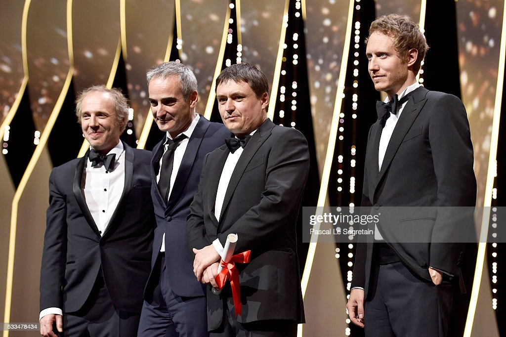 French director <a gi-track='captionPersonalityLinkClicked' href=/galleries/search?phrase=Olivier+Assayas&family=editorial&specificpeople=240407 ng-click='$event.stopPropagation()'>Olivier Assayas</a> (2ndL) and Romanian director <a gi-track='captionPersonalityLinkClicked' href=/galleries/search?phrase=Cristian+Mungiu&family=editorial&specificpeople=4292523 ng-click='$event.stopPropagation()'>Cristian Mungiu</a> (2ndR) pose on stage with members of the Jury <a gi-track='captionPersonalityLinkClicked' href=/galleries/search?phrase=Arnaud+Desplechin&family=editorial&specificpeople=2517702 ng-click='$event.stopPropagation()'>Arnaud Desplechin</a> (L) Laszlo Nemes after being both awarded with the Best Director prize respectively for the films 'Personal Shopper' and 'Aquarius' during the closing ceremony of the annual 69th Cannes Film Festival at Palais des Festivals on May 22, 2016 in Cannes, France.