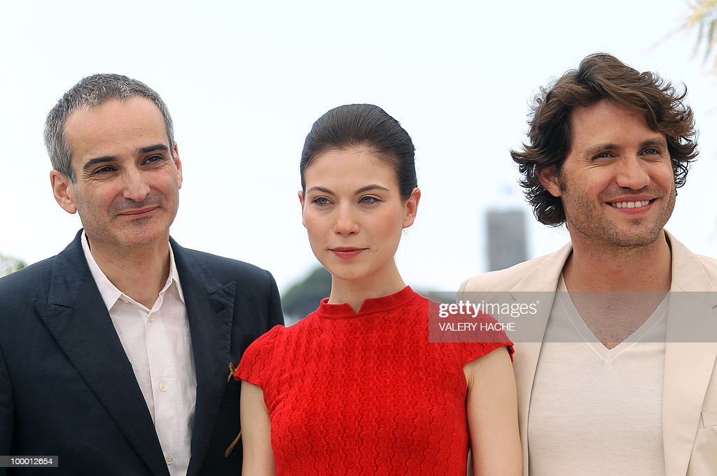 French director Olivier Assayas, Austrian actress Nora Von Waldstatten and Venezuelian born actor Edgar Ramirez pose during the photocall of 'Carlos' presented out of competition at the 63rd Cannes Film Festival on May 20, 2010 in Cannes.