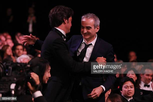 French director Olivier Assayas celebrates with French producer Charles Gillibert after being awarded with the Best Director prize for the film...
