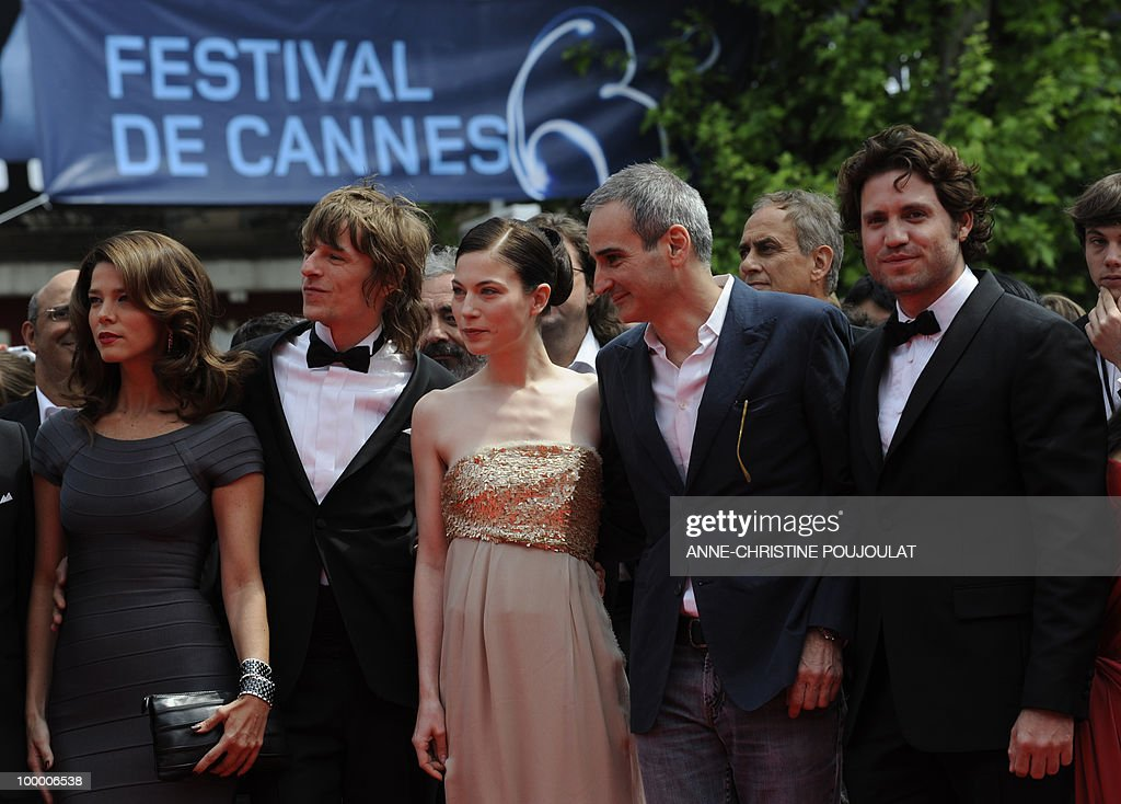 French director Olivier Assayas (2ndR), Venezuelian born actor Edgar Ramirez (R) and German actor Alexander Scheer (2ndL), Colombian actress Juana Acosta (L) arrive for the screening of 'Carlos' presented out of competition at the 63rd Cannes Film Festival on May 19, 2010 in Cannes.