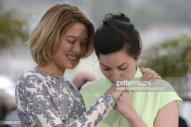French director Rebecca Zlotowski kisses on May 18 2013 the hand of actress Lea Seydoux during a photocall for the film 'Grand Central' presented in...