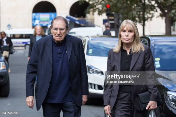 French Director Robert Hossein and his wife Candice Patou attend Mireille Darc's Funeral at Eglise Saint Sulpice on September 1 2017 in Paris France...