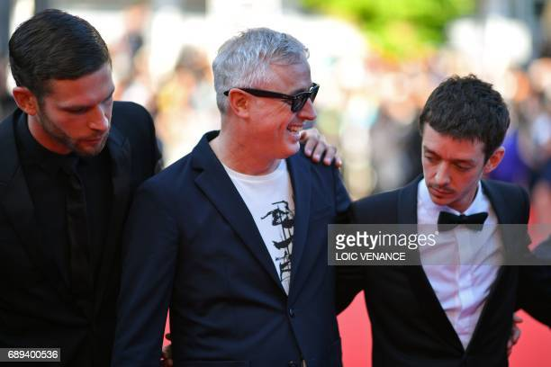 French director Robin Campillo arrives on May 28 2017 with French actor Arnaud Valois and Argentinian actor Nahuel Perez Biscayart for the closing...