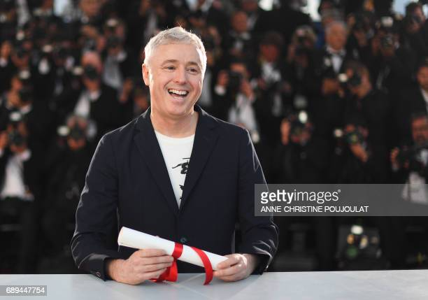 French director Robin Campillo poses on May 28 2017 during a photocall after he won the Grand Prix for the film '120 Beats Per Minute ' on May 28...
