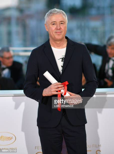 French director Robin Campillo poses on May 28 2017 during a photocall after he won the Grand Prix for the film '120 Beats Per Minute ' at the 70th...