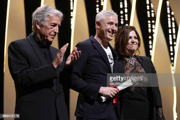 French director Robin Campillo poses on stage with Greek director CostaGavras and French actress and director and member of the Feature Film jury...