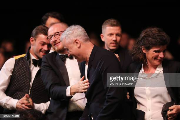 French director Robin Campillo reacts after he was awarded with the Grand Prix for his film '120 Beats Per Minute ' on May 28 2017 during the closing...