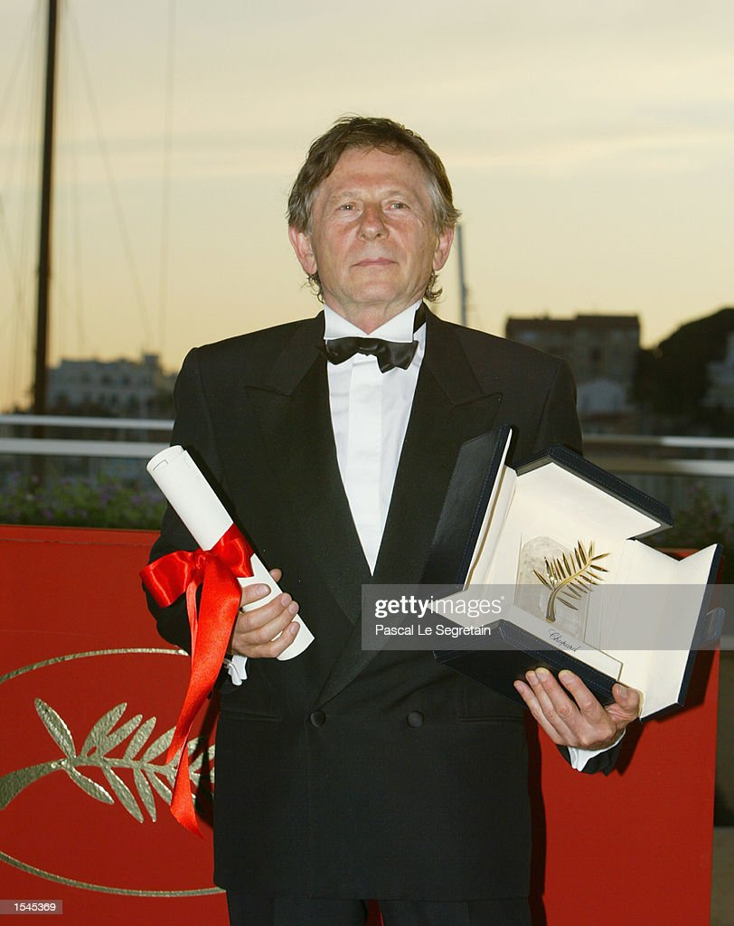 French director Roman Polanski holds his Palme d''Or (Golden Palm) award at the 55th Cannes Film Festival May 26, 2002 in Cannes, France. Polanski won the award for the film 'The Pianist,' which is a story of one man's survival in the Warsaw ghetto during World War Two.