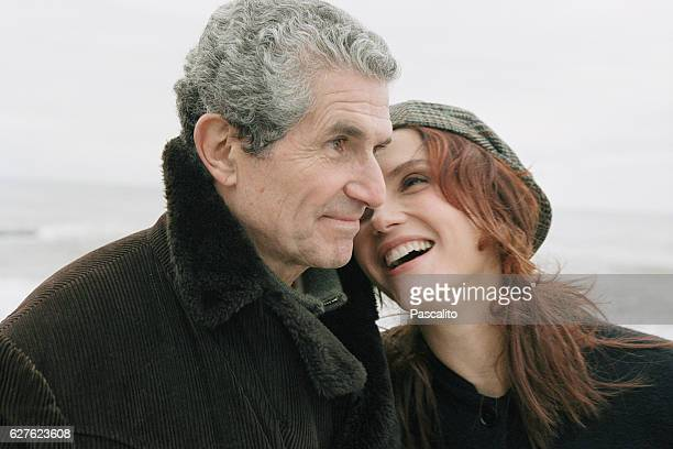French director screenwriter producer and actor Claude Lelouch and his wife Italianborn French actress Alessandra Martinez