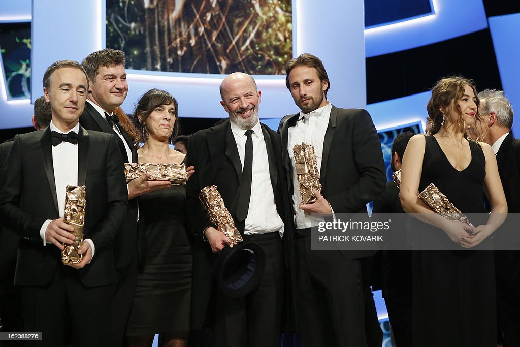 French director Sebastien Lifshitz, French writer Thomas Bidegain, French editor Juliette Welfling, French director Jacques Audiard, Belgian actor Matthias Schoenaerts and French singer and actress Izia Higelin pose with their trophies at the end of the 38th Cesar Awards ceremony on February 22, 2013 at the Chatelet theatre in Paris. AFP PHOTO / PATRICK KOVARIK