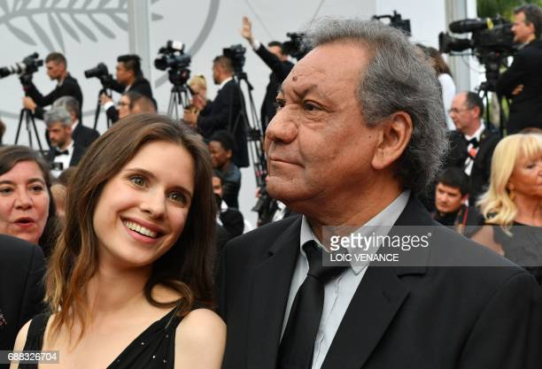 French director Tony Gatlif and actress Daphne Patakia arrive on May 25 2017 for the screening of the tv series 'Twin Peaks' at the 70th edition of...