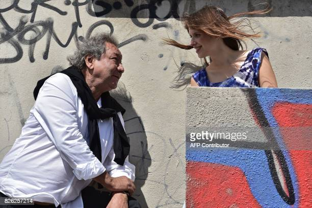 French director Tony Gatlif and Belgian actress Daphne Patakia pose in Paris on July 28 2017 Tony Gatlif tells the migrants and economic crisis in...
