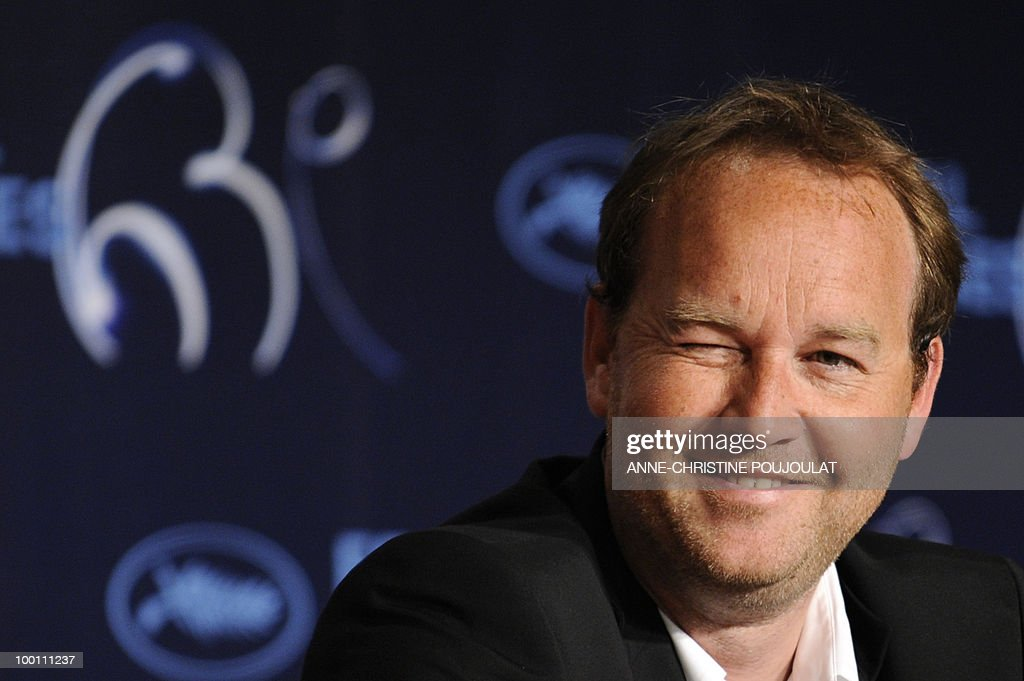 French director Xavier Beauvois blinks as he speaks during the press conference of 'Des Hommes et des Dieux' (Of God and Men) presented in competition at the 63rd Cannes Film Festival on May 18, 2010 in Cannes.