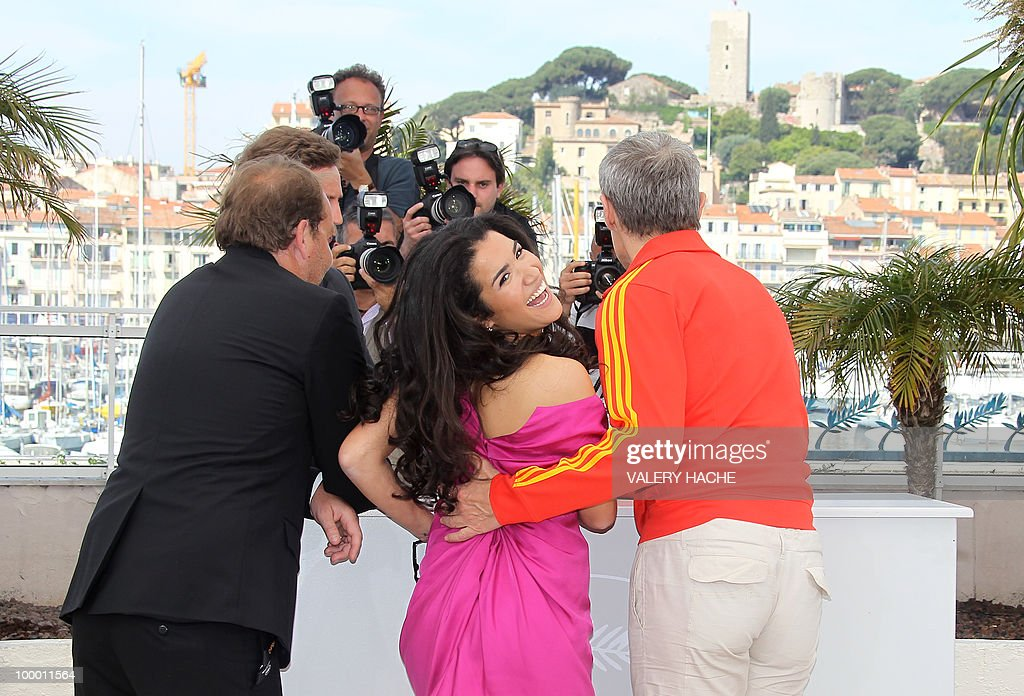 French director Xavier Beauvois, French actress Sabrina Ouazani and French actor Lambert Wilson pose during the photocall of 'Des Hommes et des Dieux' (Of God and Men) presented in competition at the 63rd Cannes Film Festival on May 18, 2010 in Cannes.