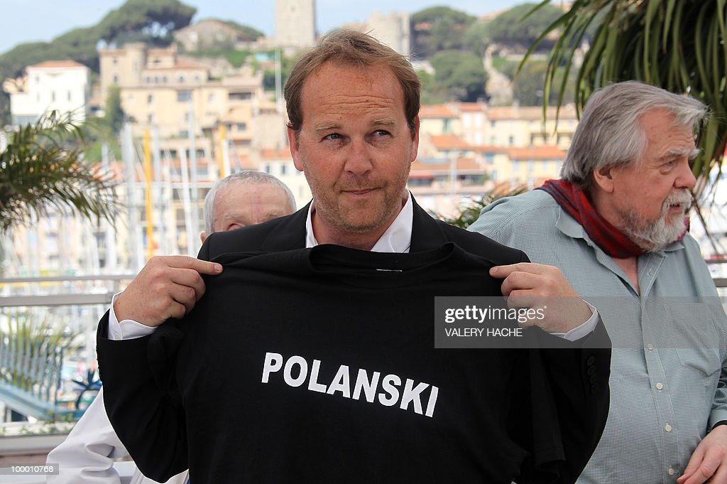 French director Xavier Beauvois poses with a tee-shirt in support of Franco-Polish director Roman Polanski during the photocall of 'Des Hommes et des Dieux' (Of God and Men) presented in competition at the 63rd Cannes Film Festival on May 18, 2010 in Cannes. (at right: Michael Lonsdale).