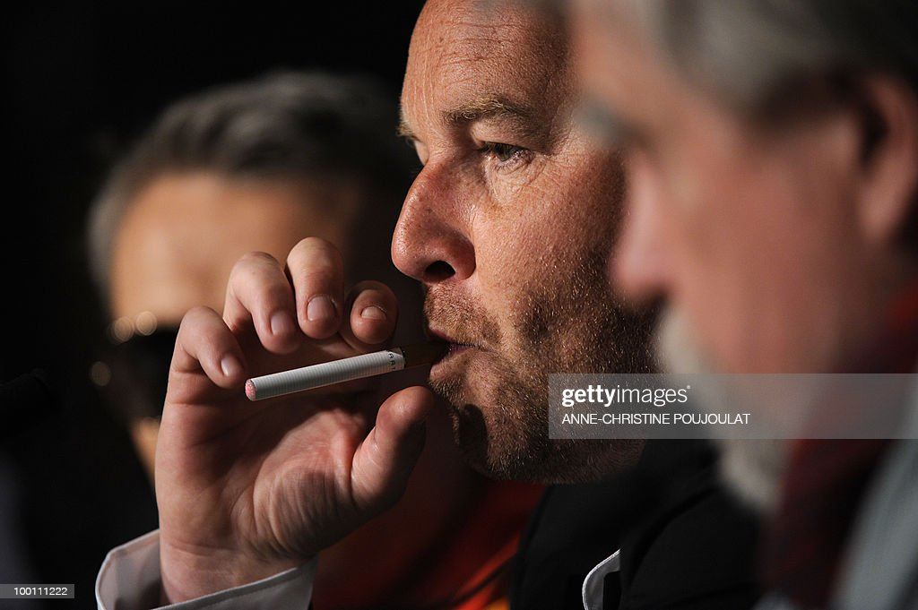 French director Xavier Beauvois smokes an electronic cigarette during the press conference of 'Des Hommes et des Dieux' (Of God and Men) presented in competition at the 63rd Cannes Film Festival on May 18, 2010 in Cannes.