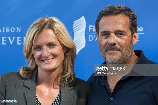 French directors Colombe Savignac and Pascal Ralite pose during a photocall for the film 'Le rire de ma mère' during the 10th Francophone Angouleme...